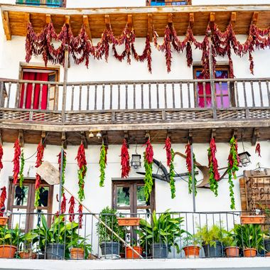 a selection of chillies and peppers being dried out on a balcony on a trip to Cazorla, Spain