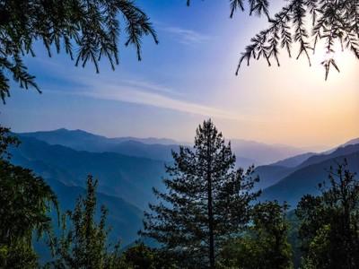 Serene layered lndscape of mountains diring sunrise...!!
