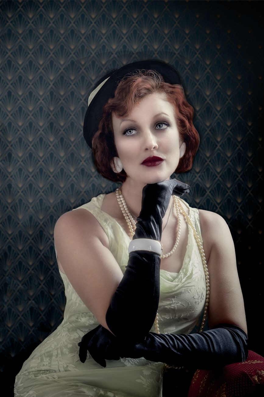 I was looking for some old time glamour with a 1930's style hat and dress from a charity shop we came up with this.