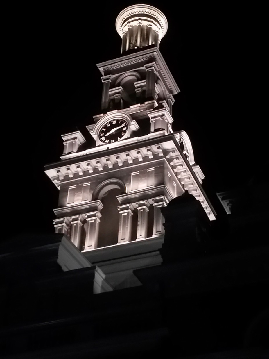 This clock/bell tower is as the title implies - newly renovated atop a courthouse in a nearby tow...