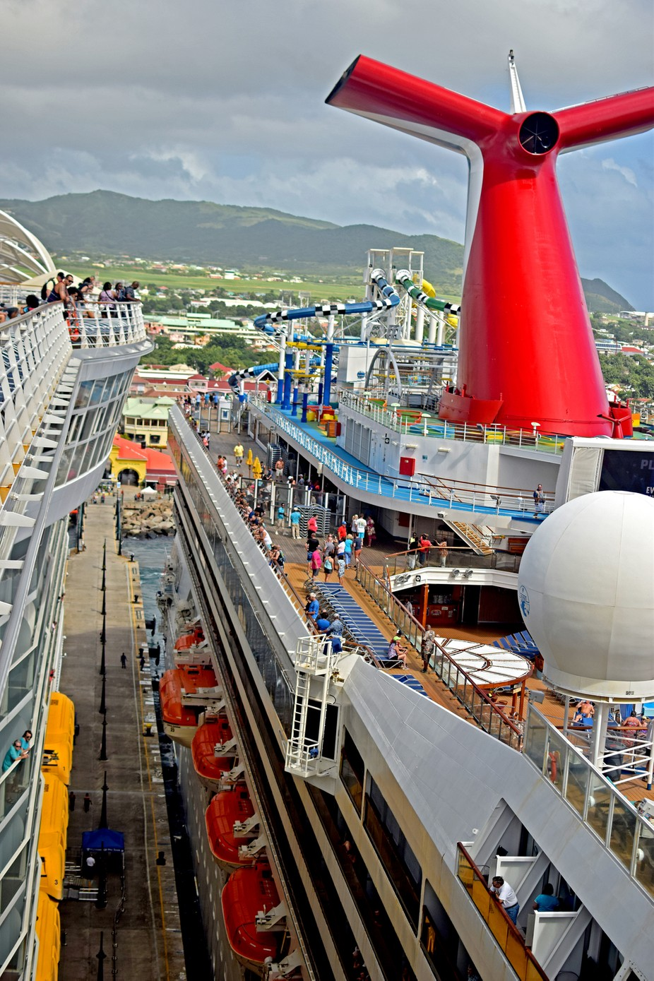 View from deck 16 of Harmony of the Seas looking down onto Carnival Sunshine at Basseterre St Kitts.