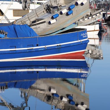 fishing boat water reflections