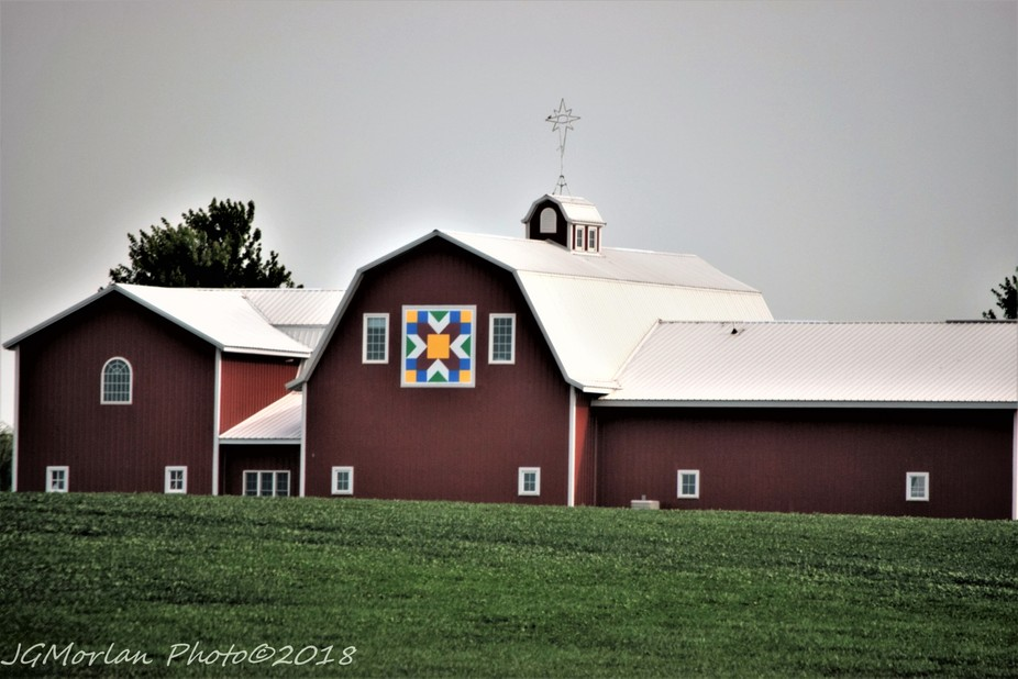 As a quilter, I not only love barn quilt signs, but this one is also hung on a beautiful barn.
