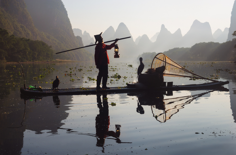 A classic image of the karst mountains and cormorant fishermen in the morning light.