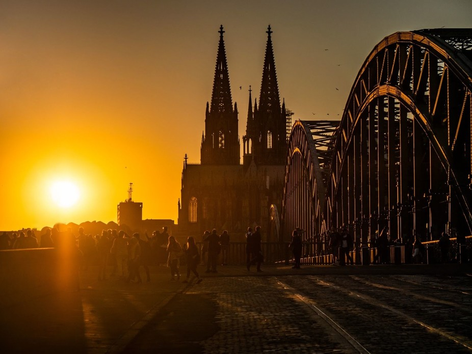 Sunset over Cologne from the most touristic place. I've stand a bit in the back to get all the people in frame.