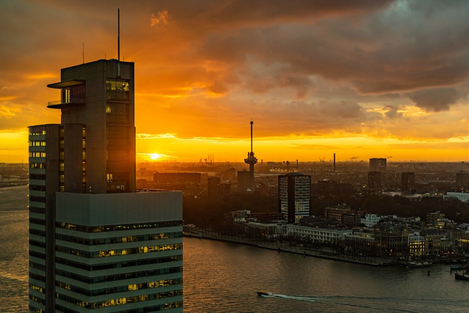 Sunset over Port area of Rotterdam with Port Of Rotterdam HQ in foreground