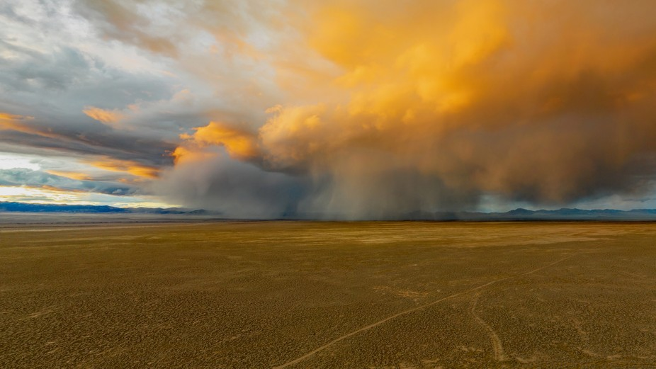 Drone shot of a storm in Utah at sunset.