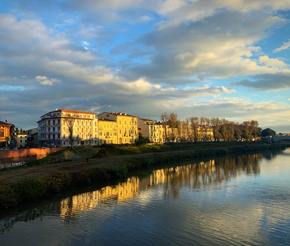 Sunset over the Arno's river in Pisa
