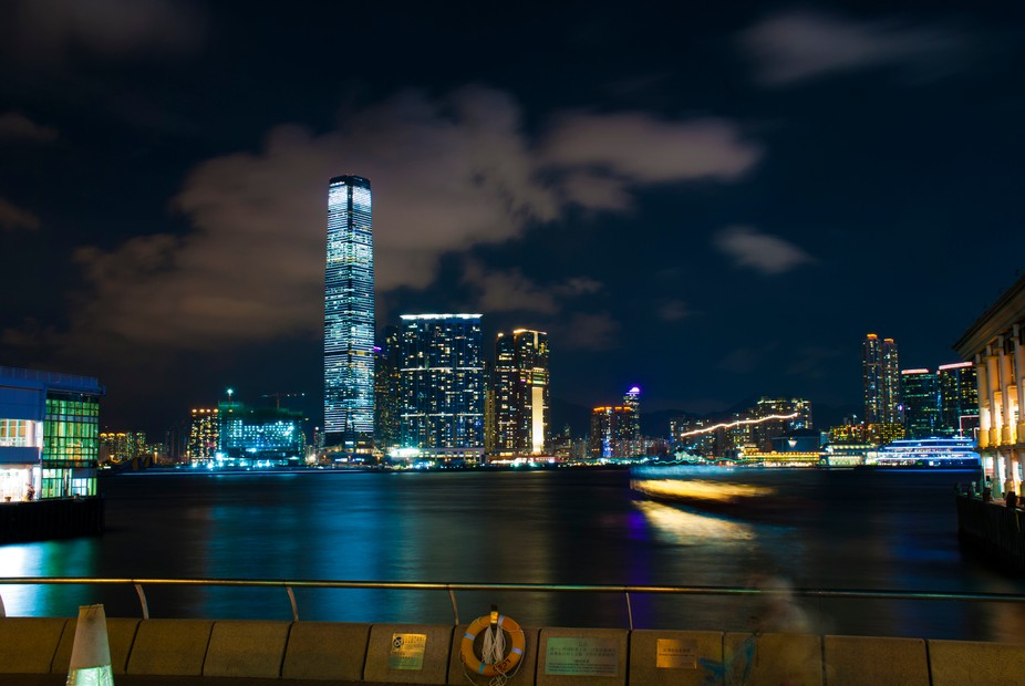 Hong Kong night life. A busy ferry going back and forth, sending people from their offices to the...