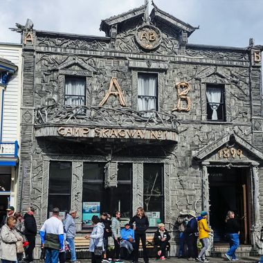 """The Most Photographer Building In Alaska"" (The Arctic Brotherhood Camp Skagway No. 1. was built in 1899.The facade, constructed a year later, consists nearly 9000 pieces of driftwood)"