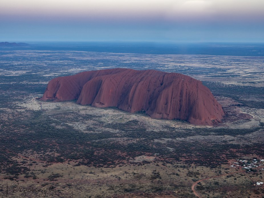 An aerial perspective of Uluru - Ayers Rock form a fixed wing plane. Not from a drone but still a...