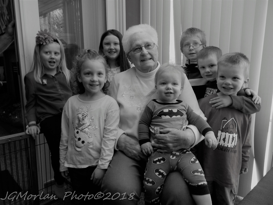 My mother and her 7 great-grandchildren.  They all called her grandma-great to distinguish her from their other great-grandma's on their other  parents' side.