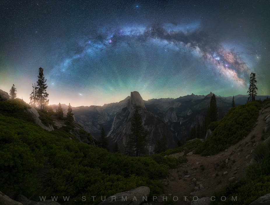 Full milky way panorama over Half dome from Glacier point in Yosemite national park.