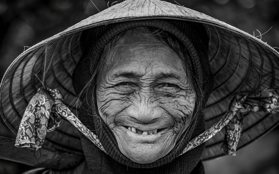 Located in the ancient village of Hoi An, Vietnam, this happy woman sells fruit to earn her livin...