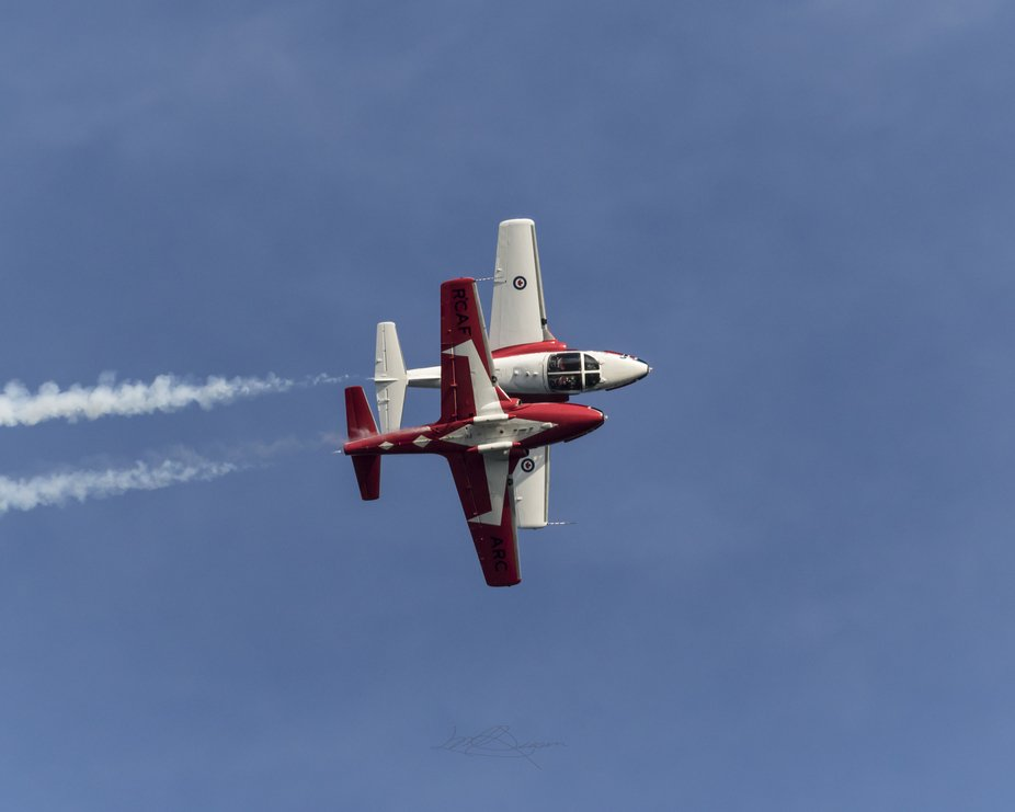 This photo is of two of the Canadian Snowbirds facing canopy to canopy, as they were flying they ...