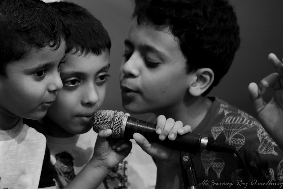 When brothers unite on a single microphone.  This photo was taken during durga puja festival when...