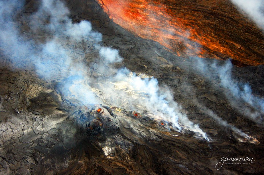Aerial photo of a crater within a crater, Kilauea volcano eruption, Big Island, Hawaii.