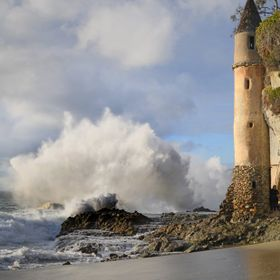 "The ""Pirate Tower"" in Laguna Beach, CA taking a pounding from some large surf"