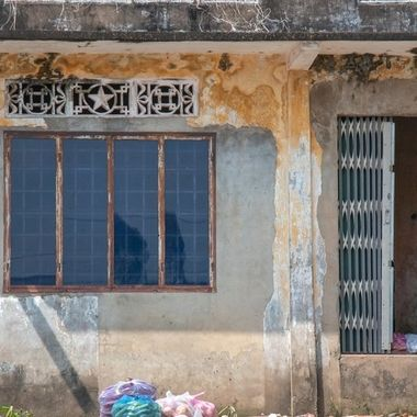 One of the many beautiful worn out houses at the waterside of the Mekong river. Vietnam