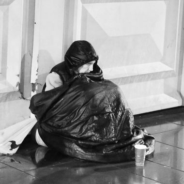 Homeless man on Waverly Bridge in Edinburgh, Scotland.