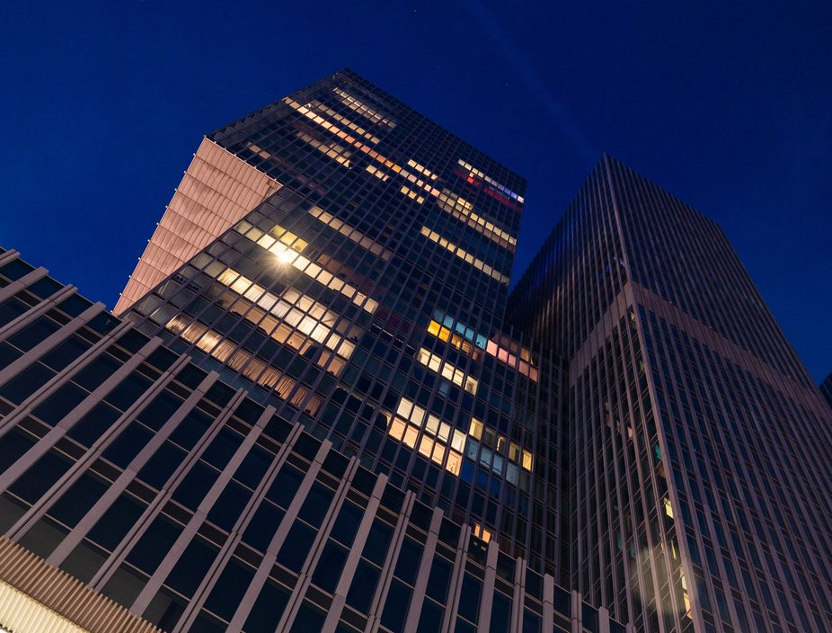 DeRotterdam - iconic building of Rotterdam. Here seen from low angle during blue hour