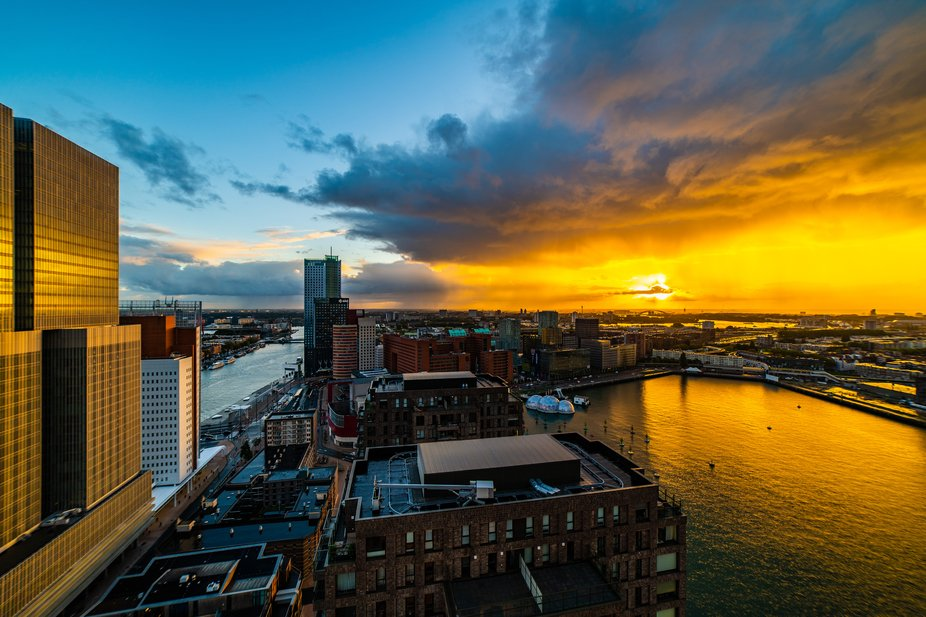 Beautiful sunrise over Rotterdam. That split between orange sun light and blue sky was spectacular.