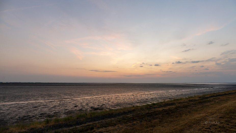 Sunset above the Eastern Scheldt near Bergen op Zoom, on the dike towards Tholen (Southern part o...