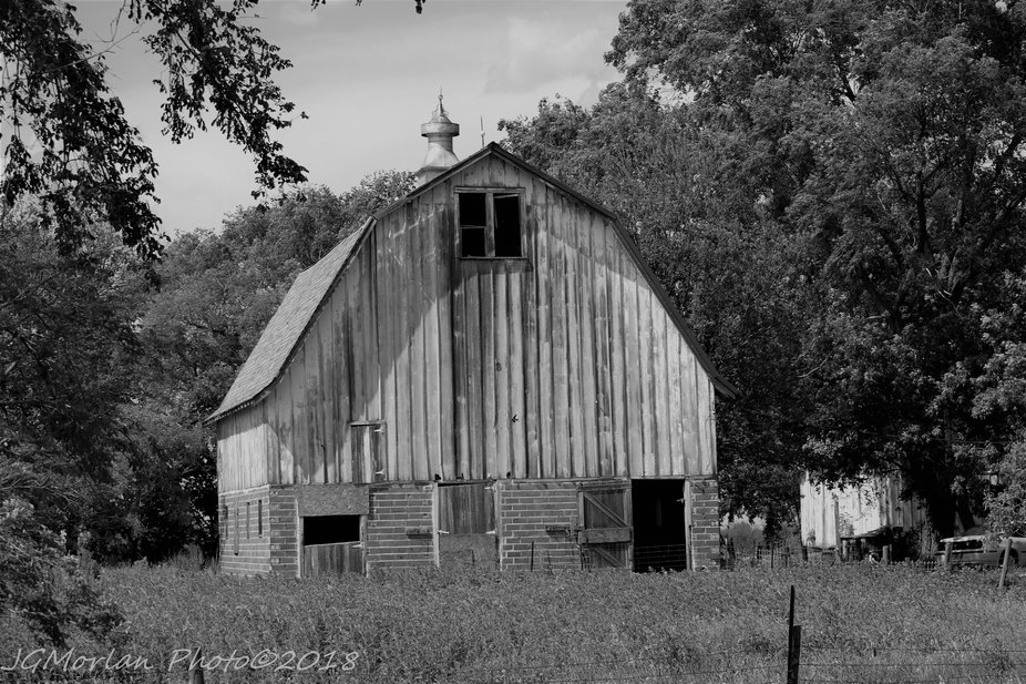 Old barn, weathered and showing its age is still holding up well