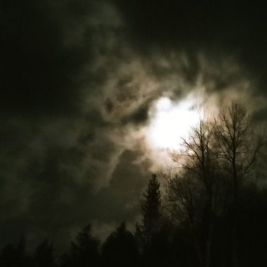 The clouds were rolling in as the moon tried to stay visible but the clouds won.