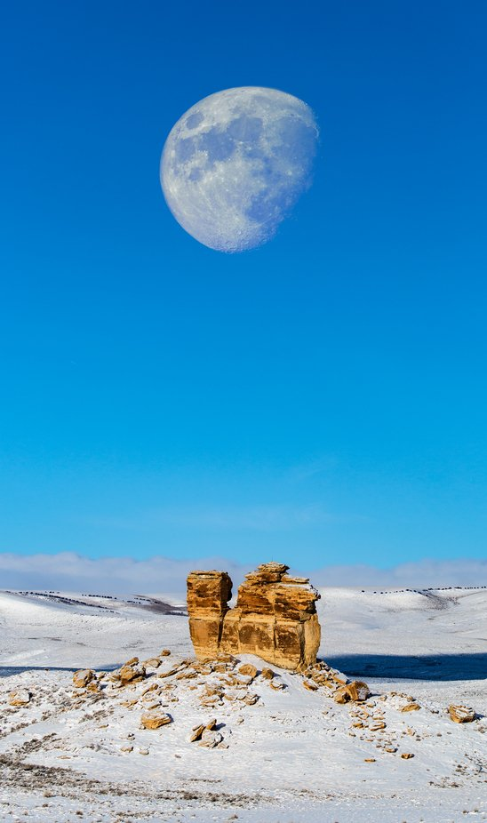 This was right outside of the Colorado border somewhere in Utah. There was a semi tailing me and I decided to pullover and let him pass, I had seen the rock before but not the moon and the placement couldn't have been better.