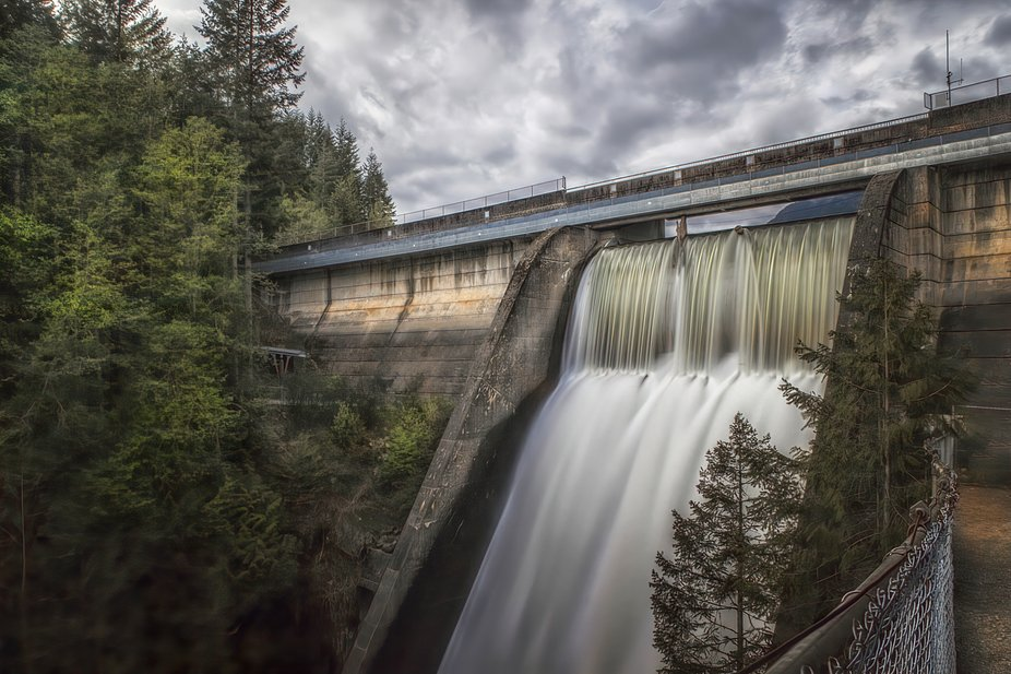 The dam is full, and so goes the overflow to control the flow.