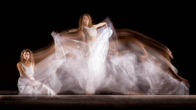 Long exposure during which a flash was fired three times. Dancer: Zvesdina