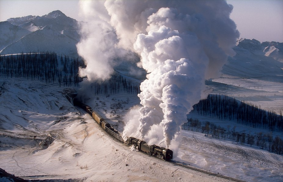 Two QJ lift a train out of Tunnel 4 on the climb to the top of the pass at Shandian.  Many ingred...
