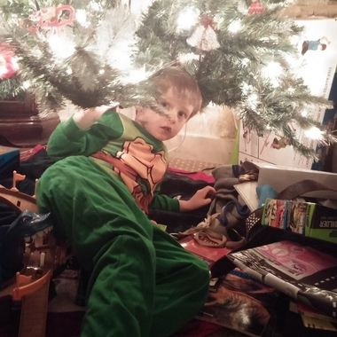 My grandson making sure he did miss a gift, lol
