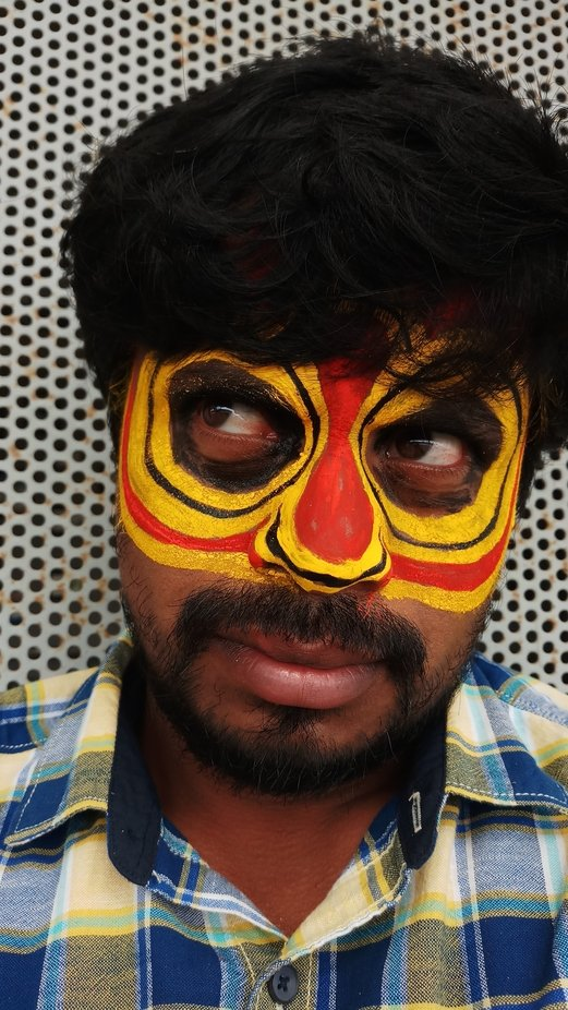 I was in a folkler art  workshop of Thereyattam  And they put face painting of a mythology charac...