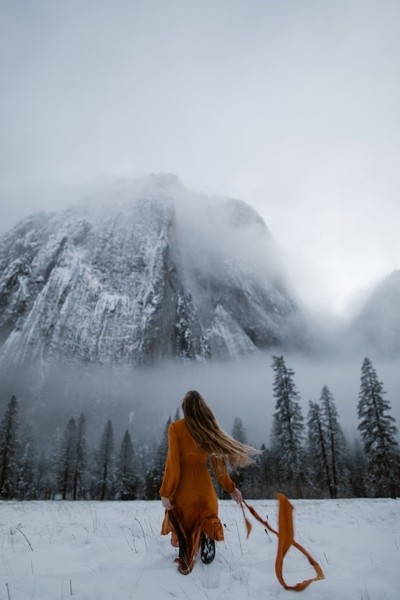 woman running in yosemite valley in the snow