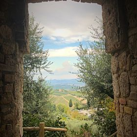 A quiet corner in San Gimignano, Italy with a view of the Tuscan countryside. Tuscany is my happy place.