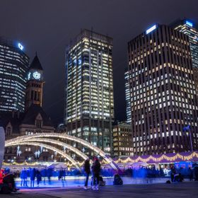 Nathan Phillips Square is a Toronto gathering place, where skating in the winter months is a past-time for locals and visitors alike.