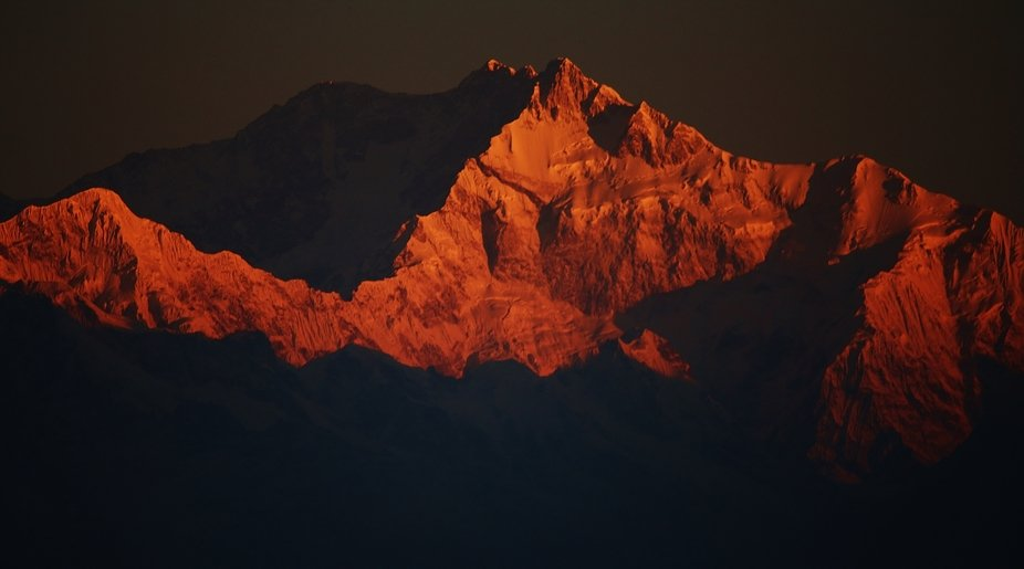 Close up of the peak of Mt. Kanchenjunga, the third highest peak in the world, as the rays of the...