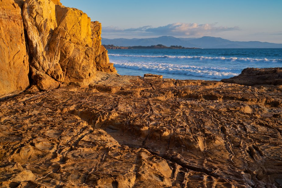Photo of the beach from the rocks. Contrast of warm and cold colors.