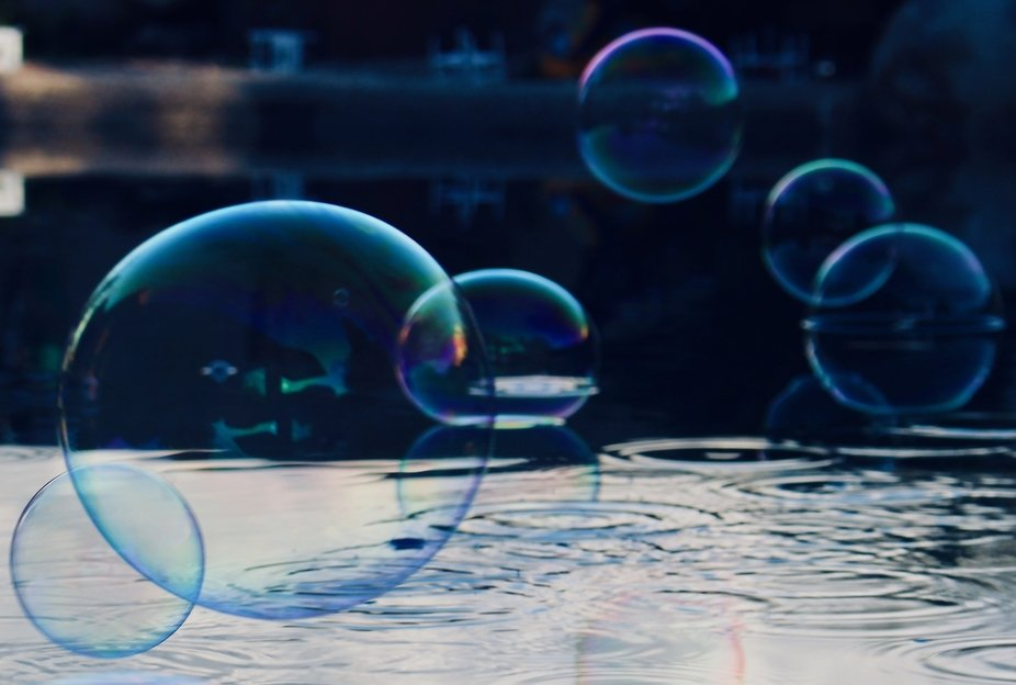 The air was still and the bubbles landed on the water as if we placed them.