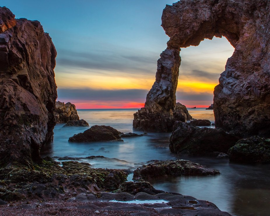 A natural arch shaped by thousands of years of ocean water flowing in and out