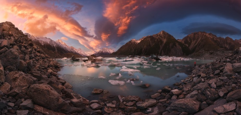 Incredible sunset in the Tasman Lake in Mount Cook National Park of New Zealand