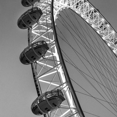 a close up shot taken of the London eye whilst on holiday in the city of London in black and white