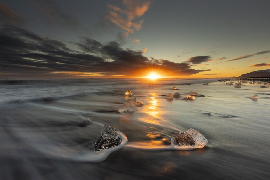 Diamond beach in Iceland, floating ice cubes during sunset