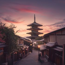 Japanese Yasaka pagoda light in the evening at sunset in the middle of a traditional street with wooden houses in Kyoto. Japan.