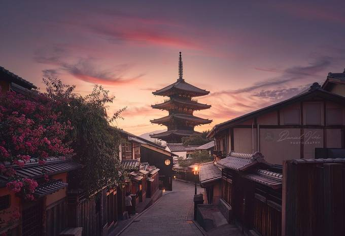 Japanese Yasaka pagoda light in the evening at sunset in the middle of a traditional street with wooden houses in Kyoto. Japan. by Danielvg - The Magic Of Japan Photo Contest