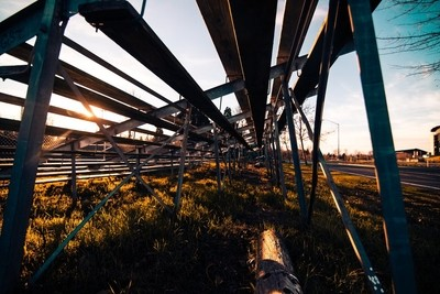 under the bleachers (right in the sun)
