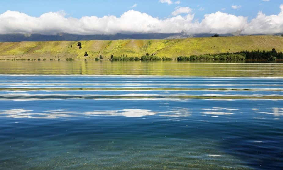 I was taking shots of this calm lake when a speed boat raced by causing these colourful ripples w...