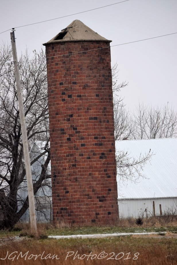 old brick silo on farm outside of town